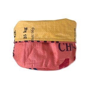 Mittelgroßer nachhaltiger Pflanzenbehälter Utensilo aus recycelten Reissack Ri32 Orange 4 vorne gekrempelt